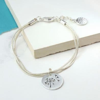 Silver Plated Triple Strand Bracelet with a Dandelion Disc